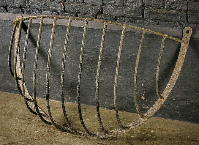 Large antique cast iron hay rack horse feeder