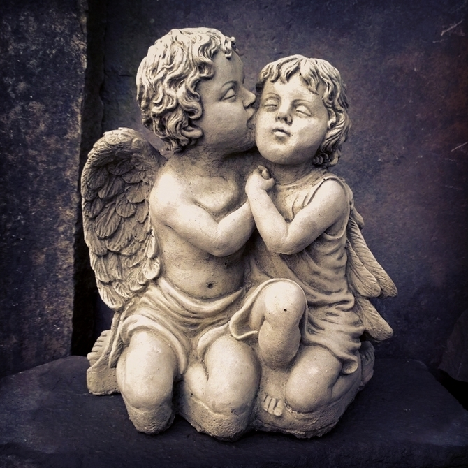 Cherubs Kissing