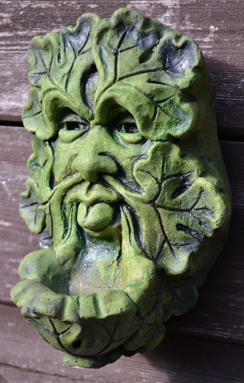 Green man wall plaque poking out his tongue