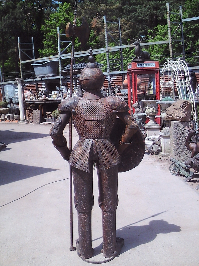 Old style knight statue with candle holder inside